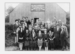 Pictured at The Glad Tidings Mission Hall at the Mills, Dromore in about 1930 are L to R:  (front row) Maisie Jackson, Mrs. Magill, Miss Morrell – Missionary, Miss Hearsey, Mrs. Thomas, Mrs. Hunter, Mrs. Miskimmons and Miss Lilley.  (second row)  Barbara Ireland, Ena Purdy, Sammy Lunn, Minnie Beggs, Madge Miskimmons, Tina Jackson, Willie Purdy, Bobby Baxter, Sam Miskimmons, Evelyn Harvey and Mary Emily Harvey.  (third row)  Aggie Harvey, Maggie Harvey, Miss Kilpatrick, Maggie Hunter, Minnie McDowell, Mrs. Morrison, Mrs. Taylor and John Beggs.  (fourth row)  Ella Gibson, May Purdy, Mrs. McGrath, Sam Black, Billy Marshall, Tommy Kerr, Wilfie Taylor and Billy Hunter.